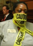 Representative Simone Bell (D-Atlanta) protests the Senate's passage of HB 954